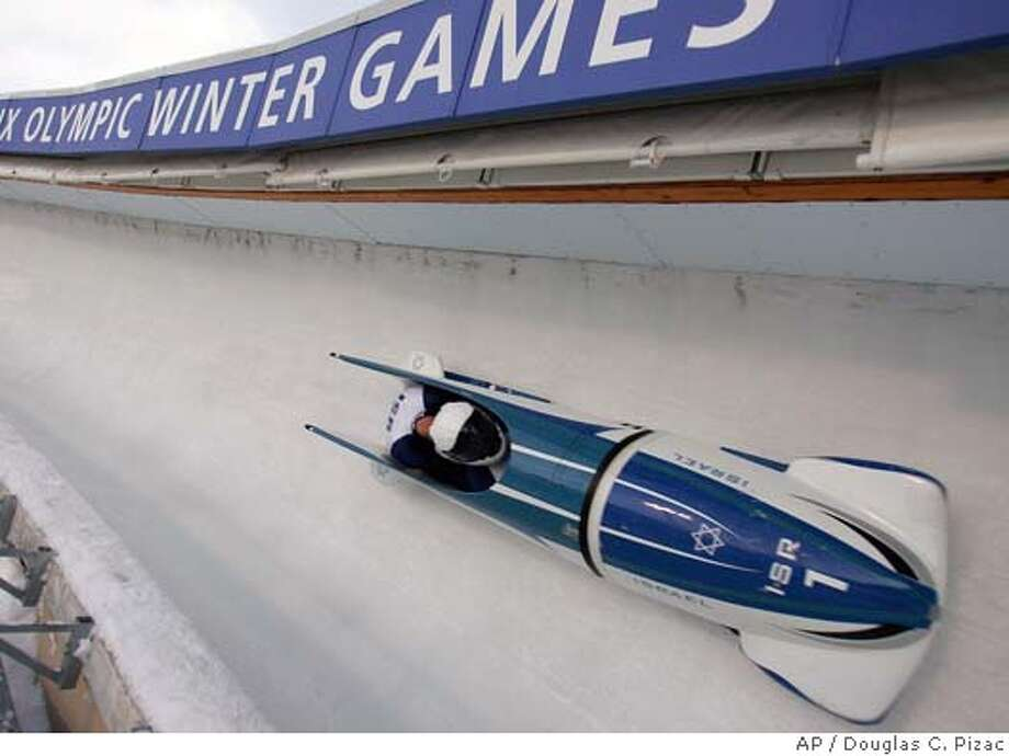 Israel's Arone Zaff and John Frank take turn 12 during the America's Cup bobsled race Monday, Dec. 6, 2004, in Park City, Utah. They finished in 13th place. The event was held at the Utah Olympic Park, venue for the 2002 Winter Games. (AP Photo/Douglas C. Pizac) Photo: DOUGLAS C. PIZAC