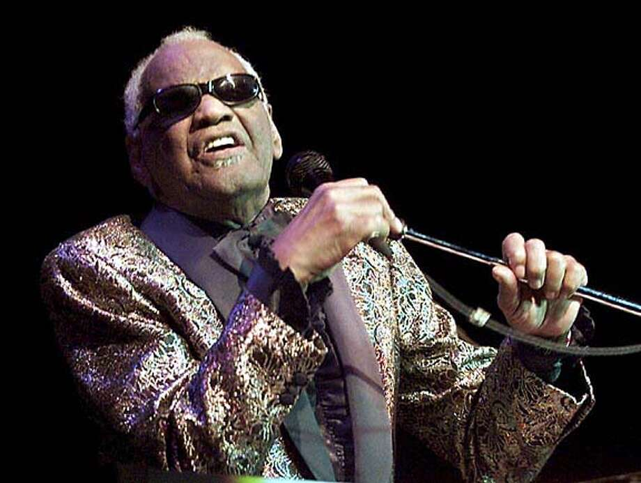 **FILE** Music legend Ray Charles performs in Zurich, Switzerland, in this Nov. 19, 2001file photo. Friends of the late Ray Charles will sing his praises during a tribute concert planned for the fall. Bill Cosby will host and Michael McDonald, James Ingram, Gerald Levert and Angie Stone are slated to perform at the Sept. 29, 2004 concert (AP Photo/Keystone, Franco Greco) Photo: FRANCO GRECO