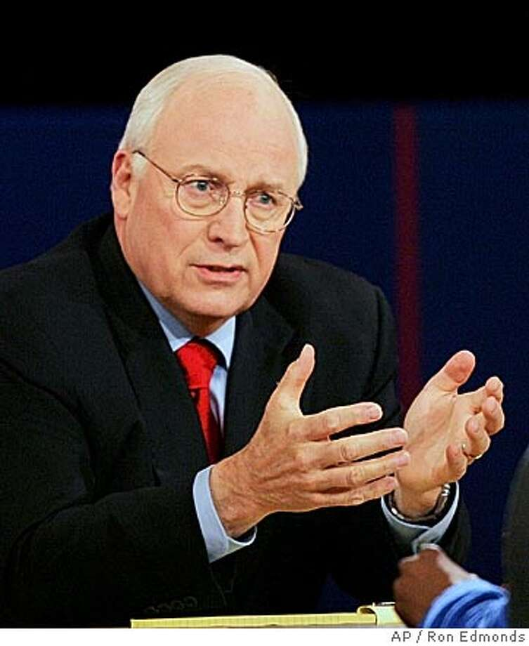 Vice President Dick Cheney answers a question during the vice presidential debate in Cleveland, Tuesday, Oct. 5, 2004. (AP Photo/Ron Edmonds) Ran on: 10-07-2004  Face off: Vice President Dick Cheney and Sen. John Edwards verbally tussled during the debate in Cleveland. IMAGE MADE AT 9:23 PM EDT Photo: RON EDMONDS