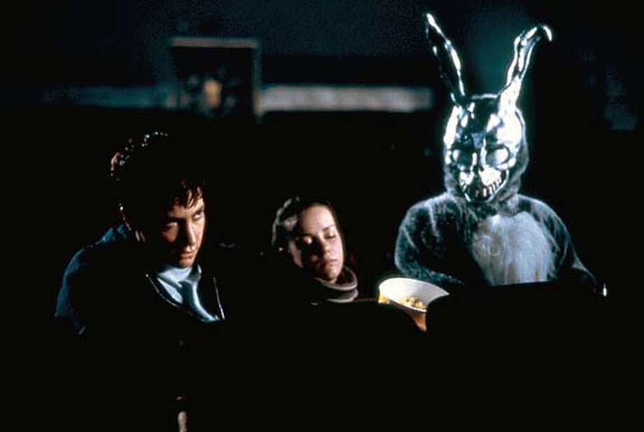 "Jake Gyllenhaal and Jena Malone and ""Frank"" in Donnie Darko"