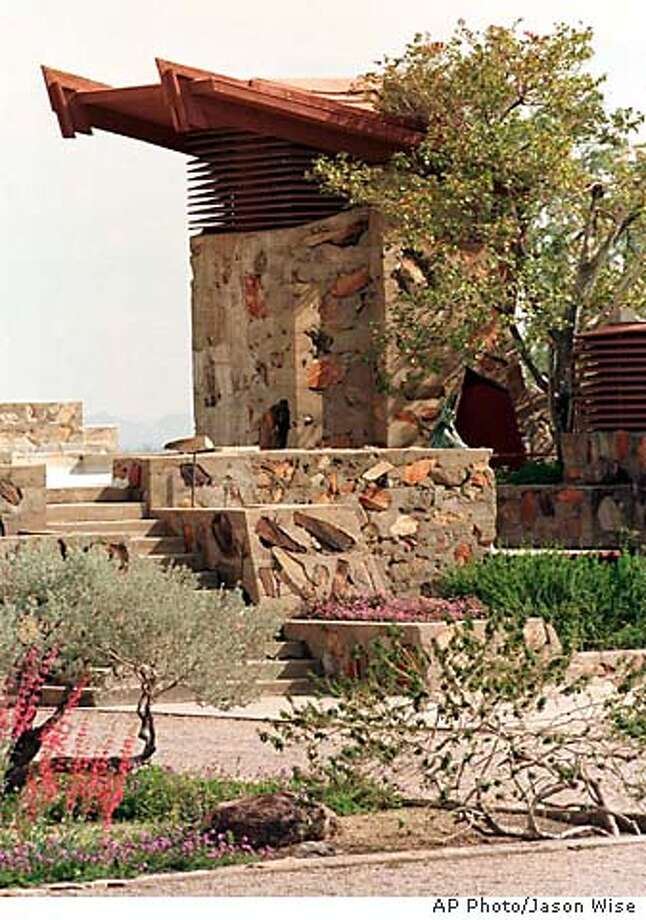 ADVANCE FOR WEEKEND EDITIONS, APRIL 19-22--Frank Lloyd Wright designed his winter home, Taliesin West, in Arizona's Sonoran Desert to complement the environment with sharp angles and sloping roofs. The famed architect's house, shown from the rear March 20, 2001, is in a 600-acre complex about 26 miles east of Phoenix. (AP Photo/Jason Wise) Photo: JASON WISE