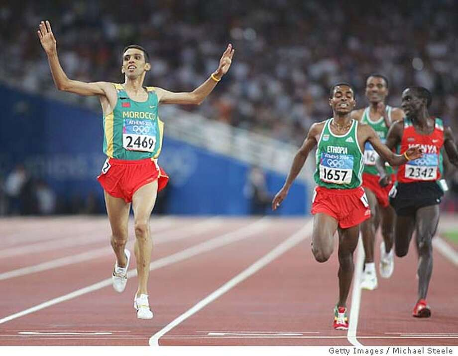 ATHENS - AUGUST 28: Hicham El Guerrouj of Morocco celebrates as he crosses the finish line and win's the men's 5,000 metre final on August 28, 2004 during the Athens 2004 Summer Olympic Games at the Olympic Stadium in the Sports Complex in Athens, Greece. (Photo by Michael Steele/Getty Images) *** Local Caption *** Hicham El Guerrouj Photo: Michael Steele