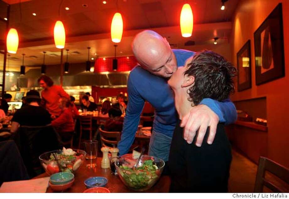 "Ken Weichert kissing his wife Stephanie after having dinner at the Fireside cafe in Metreon and going to see the movie ""Hitch"" on a Friday night. Shot in San Francisco on 2/18/05. Photo: Liz Hafalia"
