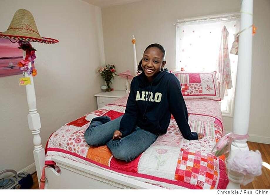 Teenager Aida Teklemariam in her bedroom on 1/29/05 in Oakland, CA.  PAUL CHINN/The Chronicle Photo: PAUL CHINN