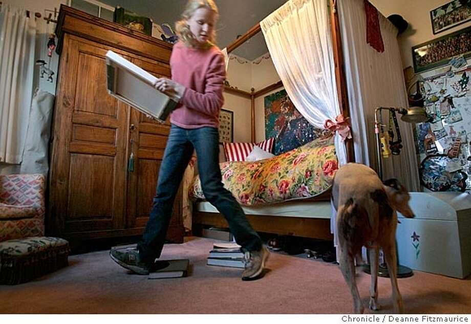Jillian Varonin is a teen with a well-decorated bedroom in her home in Corta Madera. Her dog, Bella, is at right. 1/19/05 in Corte Madera,CA.  Deanne Fitzmaurice/THE CHRONICLE Photo: Deanne Fitzmaurice