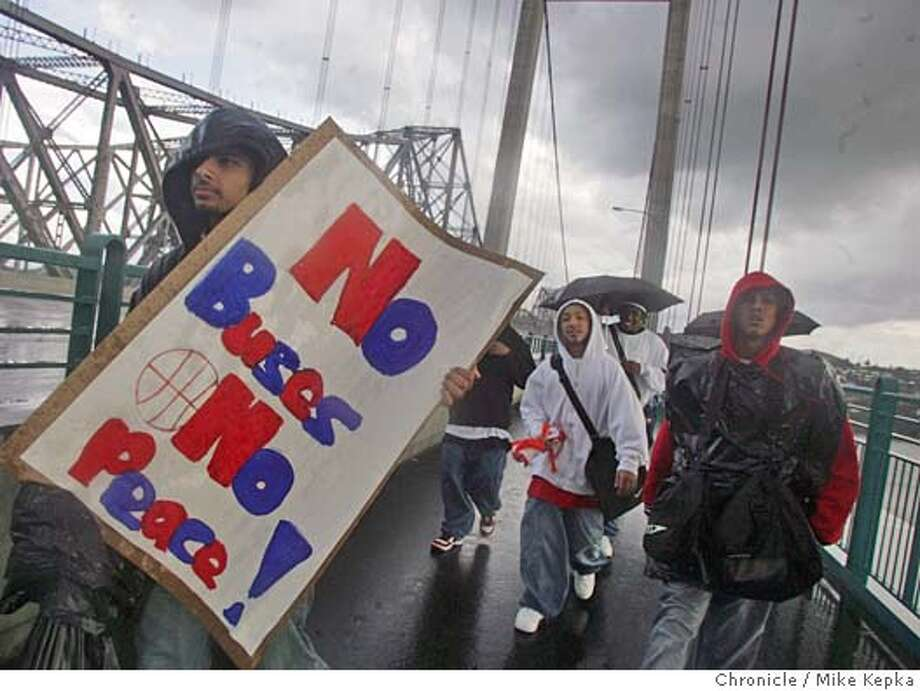 walk19134_mk.jpg  On their way to Vallejo for a basketball game, John Swett High School basketball player Kamal Thaadi, 16, leads his teammates across the Carquinez Bridge in protest of budget cuts the eliminated buses for teams sports at their school. Mike Kepka / The Chronicle MANDATORY CREDIT FOR PHOTOG AND SF CHRONICLE/ -MAGS OUT Photo: Mike Kepka