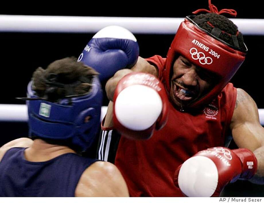 American Andre Ward, from Oakland, Calif., right, delivers a blow to Belarus' Magomed Aripgadjiev during the light heavyweight boxing final in the 2004 Athens Summer Olympic Games at the Peristeri boxing hall in Athens Sunday, Aug. 29, 2004. Ward won the match to capture the gold medal. (AP Photo/Murad Sezer) Photo: MURAD SEZER