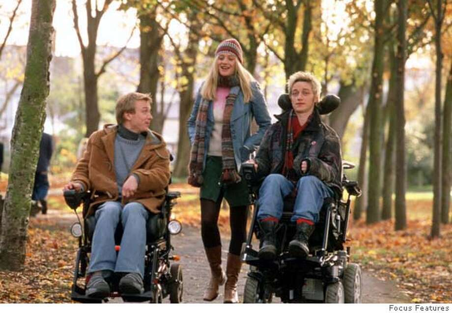 "In this photo provided by Focus Features, (l-r.) Michael (Steven Robertson), Siobhn (Romola Garai), and Rory (James McAvoy) savor the day in ""Rory O'Shea Was Here."" (Focus Features)"