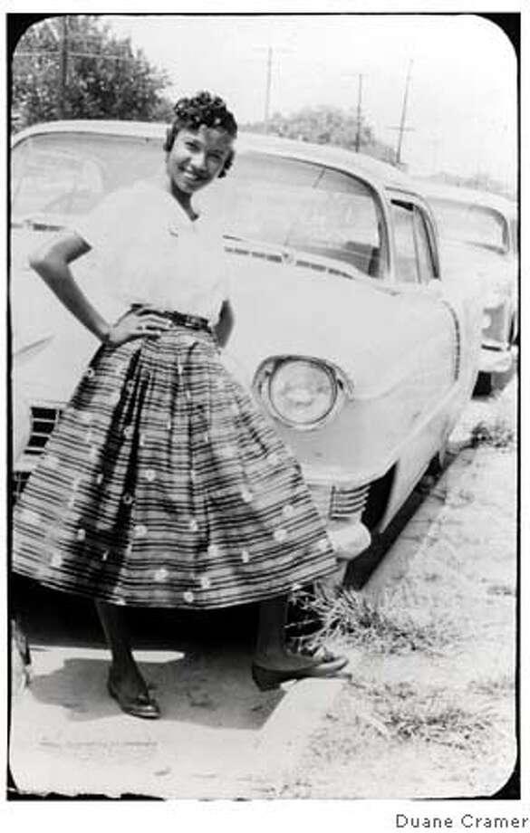 #8  Beedie Laverne Brazos  Houston, Texas  Circa 1955 Photo Description: Young woman smiling with hands on her hips standing in front of an old car with one foot on the curb of the road. Notes:Beedie is between 15 and 17 years of age (information from Beedie Laverne). Her fist marriage was to Joe J. Cramer, Jr. in 1961. Beedie and Joe Cramer had 3 children Duane Joseph Cramer b. Oct 21, 1962 Bloomington, IN, Imelda Adelle Cramer b. Nov. 9, 1963 Bellefonte, PA and Cynthia Laverne Cramer b. Nov 19, 1964 Bellefonte, PA. Birth date and Place: August 9, 1938 - Houston, TX Death: LIVING in Chicago, Illinois Relation to Duane Joseph Cramer: Beedie Laverne Fears Brazos is Duane�s mother. She is daughter of Beedie Fears Brazos and Freddie Brazos.  Photo from Duane Cramer