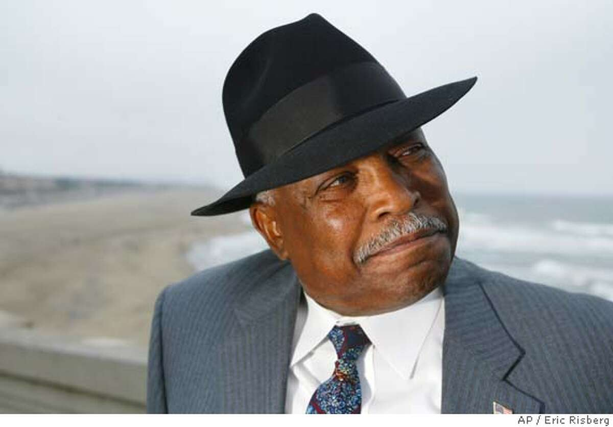 """San Francisco police chief Earl Sanders poses for a picture below the Cliff House with Ocean Beach in the background in San Francisco, Wednesday July 2, 2003. Sanders, who is on leave, is asking a judge to declare him """"factually innocent"""" of conspiring to cover up a street brawl involving three officers late last year, and to have court files including his fingerprints and mug shot destroyed. (AP Photo/Eric Risberg) CAT priority a1 3star color"""