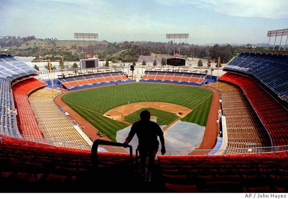 Mike Chadwick of Wakefield, RI, walks up steps at Dodger Stadium Thursday, March 19, 1998, in Los Angeles. Baseball owners overwhelmingly approved the sale of the Dodgers from Peter O'Malley to Rupert Murdoch's Fox Group. (AP Photo/John Hayes) SEE RELATED PHOTOS Photo: JOHN HAYES