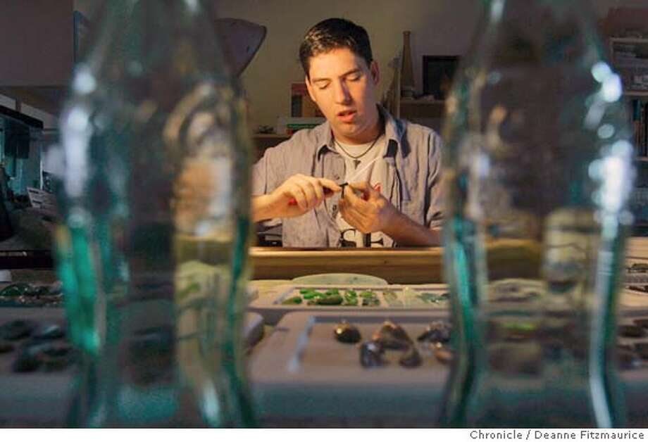 ebay18_022_df.JPG  Charles Peden, who works out of his Benicia home making sea glass jewelry, is worried about new price hikes imposed by eBay through which he sells his jewelry.  Deanne Fitzmaurice / The Chronicle Photo: Deanne Fitzmaurice