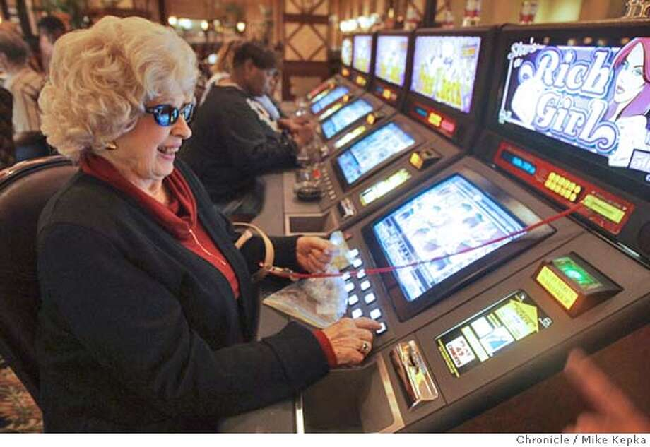 Edna Gamba, of Fremont and a member of the Fremont AARP plays the video slots at Thunder Valley.Members of the Fremont and Hayward AARP take charter a bus trip to Thunder Valley Casino near Sacramento.  MIKE KEPKA/The Chronicle Photo: MIKE KEPKA