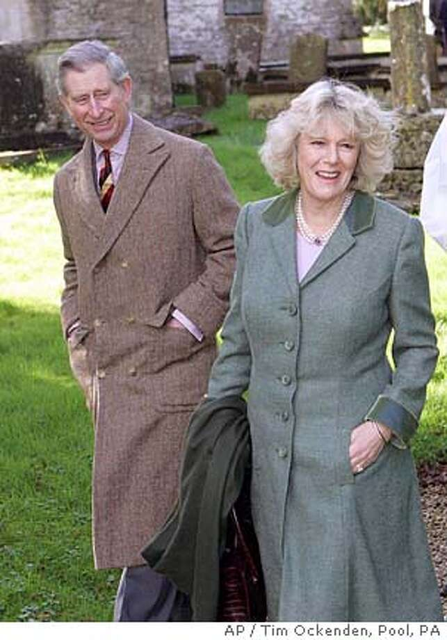 Britain's Prince Charles, the Prince of Wales and his bride-to-be Camilla Parker Bowles leave after a Sunday church service St Lawrence's Church in Didmarton, England, Sunday, Feb. 13 2005. The setting for their civil wedding will be markedly different on April 8 with the pair saying their vows in the surrounds of Windsor Castle. (AP Photo / Tim Ockenden/ Pool, PA) POOL Photo: TIM OCKENDEN