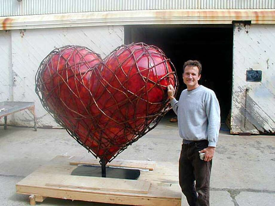 "Tor Archer with ""Entangled Heart,"" his contribution to the Hearts in San Francisco art project Photo: Hearts In San Francisco"