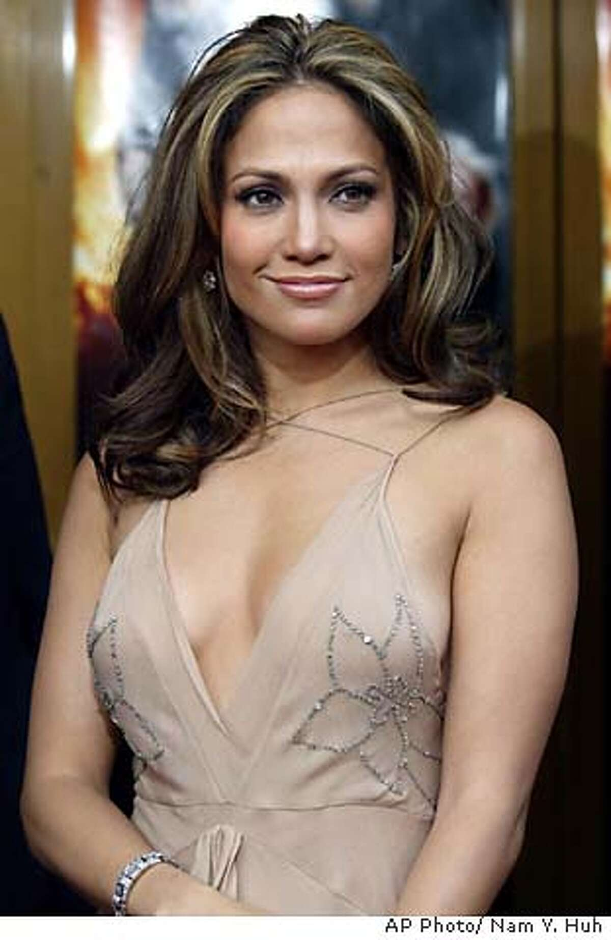 """**FILE**Actress and singer Jennifer Lopez poses for a photo as she arrives for the world premiere of Man on Fire in this April 18, 2004 file photo, in Los Angeles. In early June, Lopez reportedly married singer Marc Anthony in a small ceremony at her Beverly Hills, Calif., home. All she'll say about Anthony is, """"We have a great working relationship. I have to keep my work and my personal life separate. Otherwise it gets blurry and it gets messy.""""(AP Photo/ Nam Y. Huh) FILE"""