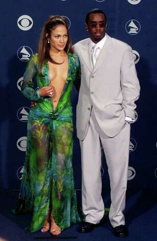 THE PLUNGE: Jennifer Lopez, shown with Sean ?Puffy? Combs, wasn?t the first to wear this plunging Versace gown, but she was the most unforgettable. Photo: REED SAXON / AP