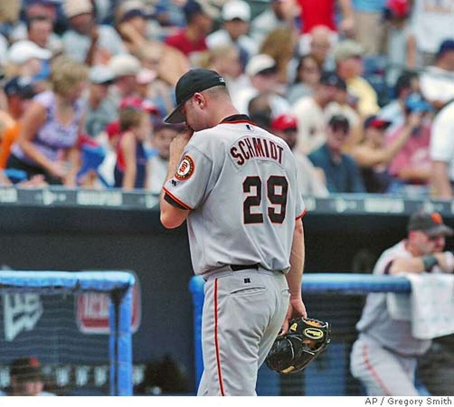 San Francisco Giants starter Jason Schmidt leaves the field after being pulled against the Atlanta Braves during the fourth inning Saturday, Aug. 28, 2004, at Turner Field in Atlanta. Schmidt gave up six run to the Braves in four innings. (AP Photo/Gregory Smith) Photo: GREGORY SMITH