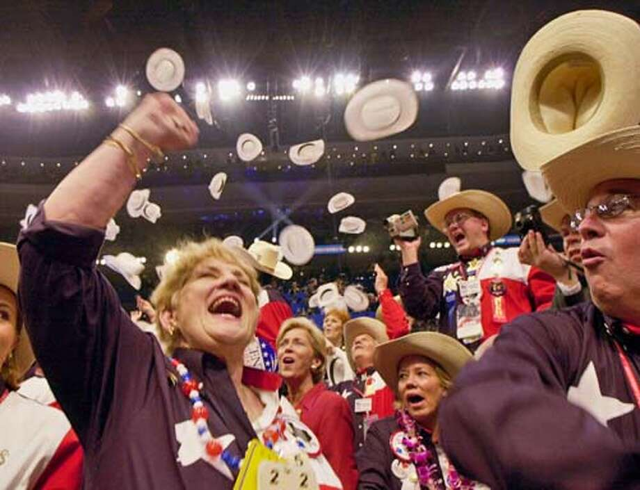 Members of the Texas delegation celebrate after the roll call vote nominating George W. Bush as the party's presidential candidiate concludes during the Republican National Convention in Philadelphia, Thursday, Aug. 3, 2000. (AP Photo/Stephan Savoia) Ran on: 08-29-2004  Texas delegates celebrate George W. Bush's nomination in 2000. Photo: STEPHAN SAVOIA