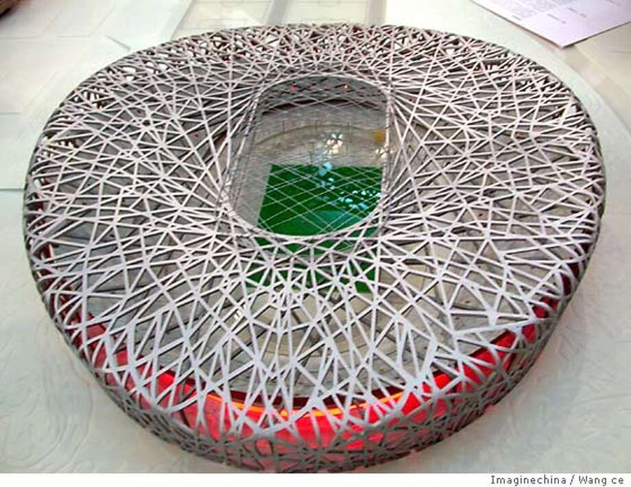 Aug 04, 2004; Beijing, CHINA; (FILE PHOTO: Mar 26, 2003) The model of Olympic stadium, based on a nest-like design, planned jointly by Swiss and Chinese architects. Organizers of the 2008 Beijing Olympics have stopped work on their 100,000-seat stadium in order to re-design it under orders to cut costs, said Zhu Jing, a spokeswoman for the organizing committee. The National Stadium, designed by Swiss architects Herzog and de Meuron, initially was budgeted at 3 billion yuan (US $360 million). Mandatory Credit: Photo by Wang ce / Imaginechina/ZUMA Press. (�) Copyright 2004 by Wang ce/Imaginechina Photo: Wang Ce/Imaginechina