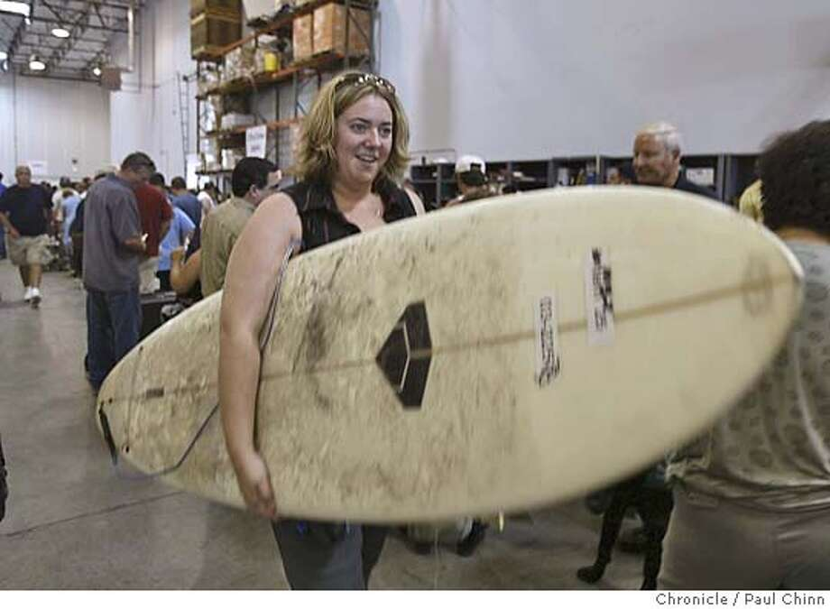 Carrie Nutter, of Sacramento, came away with a surfboard for $15. The state of California's gigantic garage sale of surplus goods in Sacramento on 8/27/04. PAUL CHINN/The Chronicle Photo: PAUL CHINN