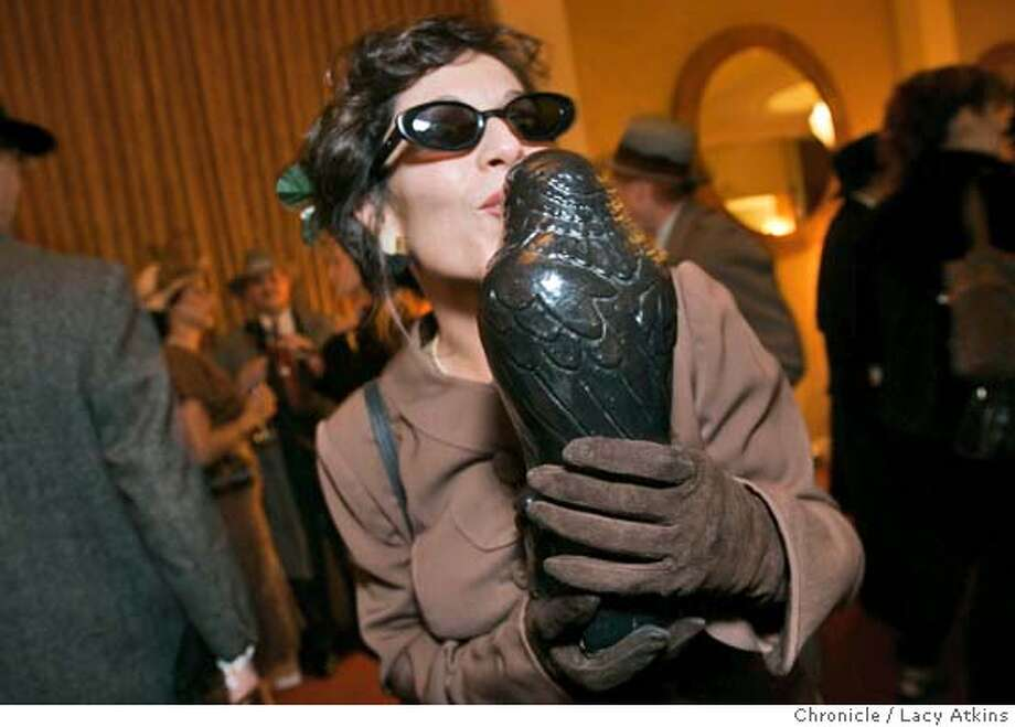 "Melissa Panages gives the Falcon a kiss for luck at the dress-up contest, Thursday Feb.16, 2005, to celebrate for 75th anniversary, in San Francisco. This is a ""Maltese Falcon"" dress-up contest being staged by John's Grill for the 75th anniversary of the book's publication  Photographer Lacy Atkins / San Francisco Chronicle Photo: LACY ATKINS"