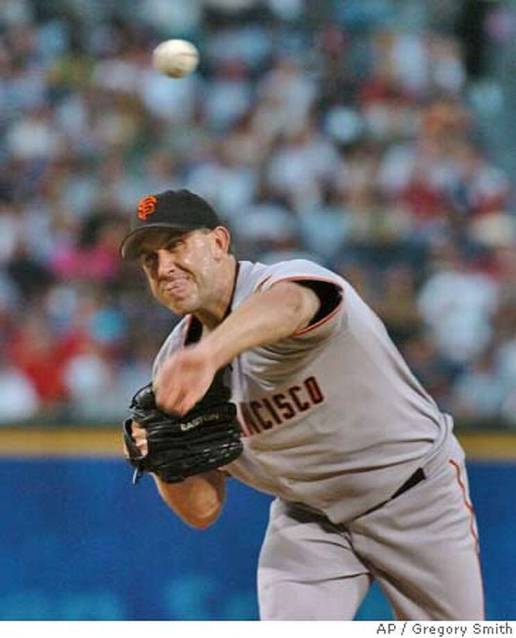San Francisco Giants starter Kirk Rueter delivers to the Atlanta Braves during the first inning Friday, Aug. 27, 2004, at Turner Field in Atlanta. (AP Photo/Gregory Smith) Photo: GREGORY SMITH