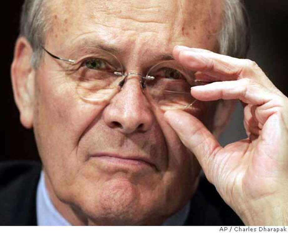 Secretary of Defense Donald Rumsfeld adjusts his glasses during testimony regarding the Pentagon's supplemental 2005 budget request for Iraq and Afghanistan at the Senate Appropriations Committee Wednesday, Feb. 16, 2005 in Washington. (AP Photo/Charles Dharapak) Photo: CHARLES DHARAPAK