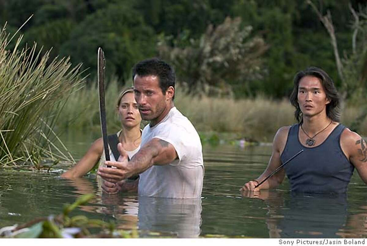 """(Left to Right) Kadee Strickland (Sam), Johnny Messner (Bill) and Karl Yune (Tran) co-star in the action horror film """"ANACONDAS: The Hunt for the Blood Orchid"""" (Sony Pictures/Jasin Boland)"""