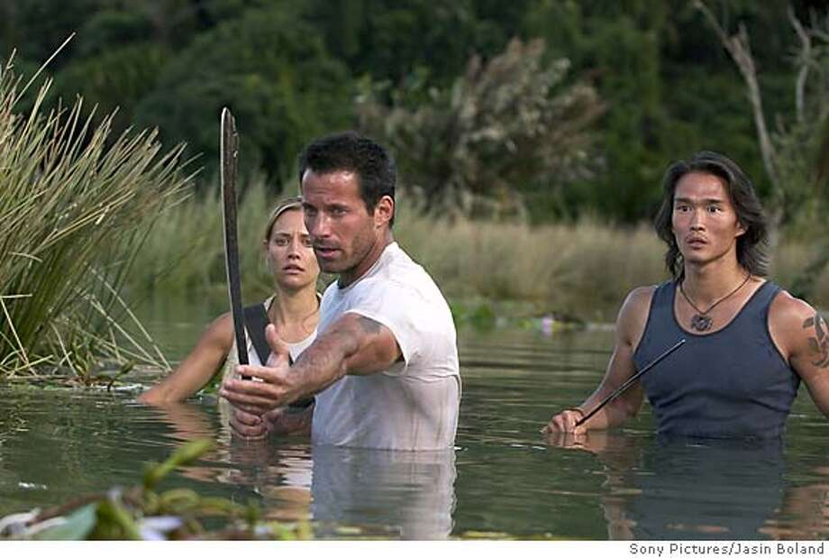 "(Left to Right) Kadee Strickland (Sam), Johnny Messner (Bill) and Karl Yune (Tran) co-star in the action horror film ""ANACONDAS: The Hunt for the Blood Orchid"" (Sony Pictures/Jasin Boland) Photo: JASIN BOLAND"