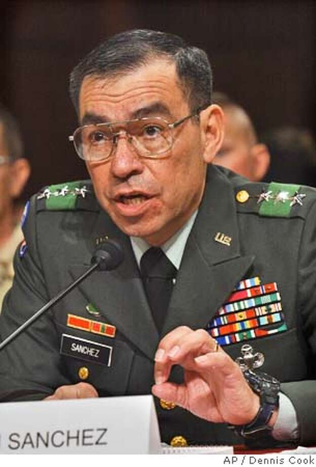 ** FILE ** Lt. Gen. Ricardo Sanchez testifies on Capitol Hill Wednesday, May 19, 2004, as the Senate Armed Services Committee continues its inquiry into allegations of the mistreatment of Iraqi prisoners. Sanchez, the top U.S. military officer in Iraq, will be replaced as part of a command restructuring that has been in the works for several months, administration officials said Tuesday, May 25, 2004. (AP Photo/Dennis Cook) Ran on: 06-10-2004  Lt. Gen. Ricardo Sanchez Ran on: 06-22-2004  An artist's sketch shows, from left, civilian attorney Paul Bergrin, his client Sgt. Javal S. Davis, defense counsel Capt. Scott Dunn, trial counsel Capt. Christopher Graveline and Judge Col. James Pohl, in the Baghdad courtroom where pretrial hearings are taking place. Ran on: 06-22-2004  An artist's sketch shows, from left, civilian attorney Paul Bergrin, his client Sgt. Javal S. Davis, defense counsel Capt. Scott Dunn, trial counsel Capt. Christopher Graveline and Judge Col. James Pohl, in the Baghdad courtroom where pretrial hearings are taking place. Photo: DENNIS COOK