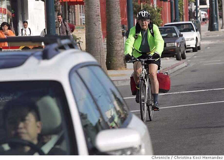 Hill rides down Ocean Ave.We're doing a feature on safe practices for urban cycling. One prime source is Bert Hill, who runs a series of classes for the San Francisco Bicycle Coalition. On Saturday, Hill will give is standard presentation at the Ingleside Police Station, 10 a.m.-2 p.m.. Afterwards, he'll pedal off on his trusty REI hybrid, laden with gear... producing our chance to get shots of him demonstrating his riding techniques on city streets. Shoot shd go pretty quickly.  City: SF, CA .CHRISTINA KOCI HERNANDEZ/CHRONICLE Photo: CHRISTINA KOCI HERNANDEZ