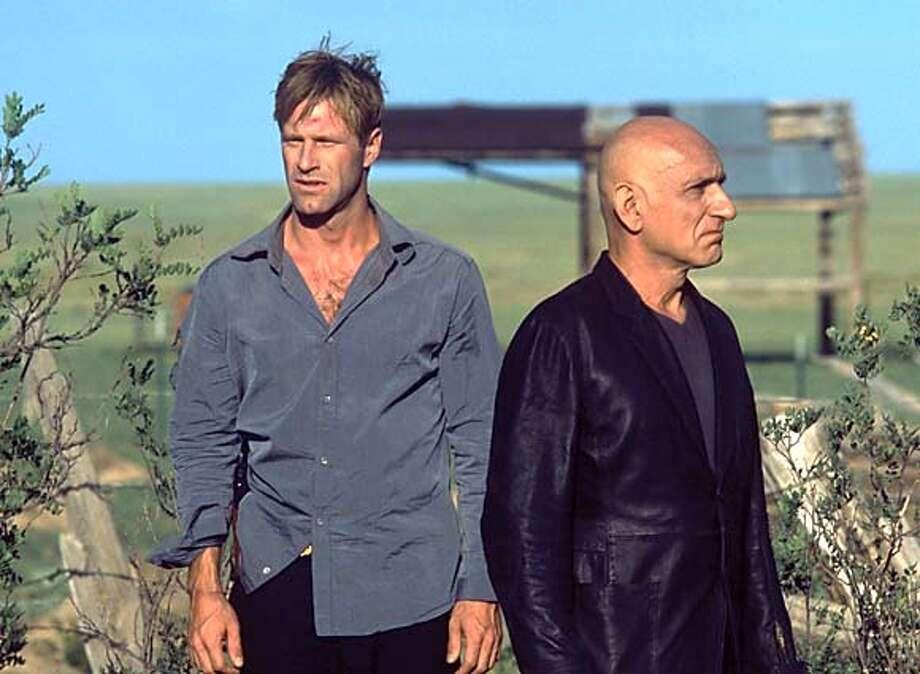 "(Left to right) Aaron Eckhart as Agent Tom Mackelway and Ben Kingsley as Benjamin O'Ryan in ""Suspect Zero."" (AP Photo/Melissa Moseley) Ran on: 08-24-2004  Aaron Eckhart stars in &quo;Suspect Zero.'' Photo: MELISSA MOSELEY"