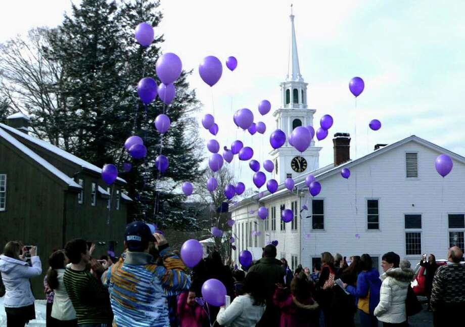 SPECTRUM/Children in the New Milford First Congregational Church school program and church members release purple balloons in tribute Sunday to the late Mary Westfall, a church member who had been dedicated to the church school program. A purple heart and note from a church school student was attached to each balloon.  Courtesy of Janet Wittman Photo: Contributed Photo