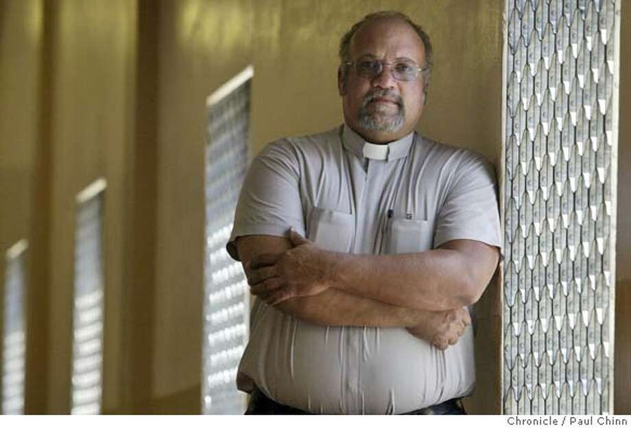Rev. Charles Tinsley stands in a hallway inside Juvenile Hall. Tinsley, chaplain at Contra Costa�s Juvenile Hall, advises the wards from Richmond�s hard-luck neighborhoods go east, west, north or south � anywhere to leave the �hood that delivered them into the criminal system. Contra Costa Co. Juvenile Hall in Martinez on 8/26/04. PAUL CHINN/The Chronicle Photo: PAUL CHINN