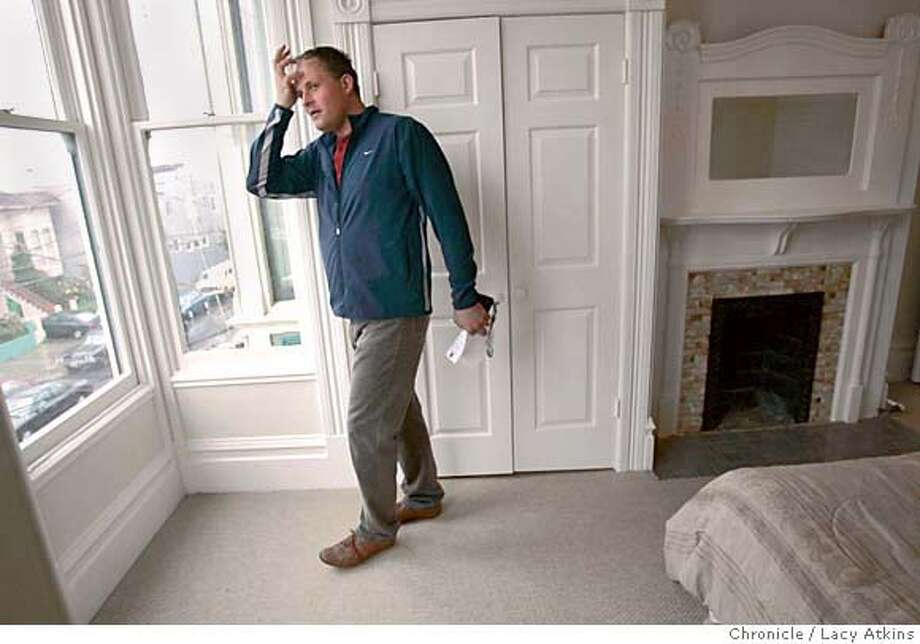 Piotr Mazurek (909-720-0508) checks out the view from one of the bedrooms of the Inner Mission 4 Unit Victorian during the brokers open house, Tuesday Feb.15, 2005, in San Francisco. Bay Area home sales experienced their strongest January in 16 years as prices rose at their fastest pace in four years, DataQuick Information Systems, a real estate information service, reported Tuesday. A total of 7,509 new and resale houses and condos were sold in the nine-county region in January. Though that was down 32.2 percent from 11,068 in December, it was up 5.7 percent from 7,102 for January 2004 and the strongest for any January since 7,646 in 1989.  Photographer Lacy Atkins / San Francisco Chronicle Photo: LACY ATKINS