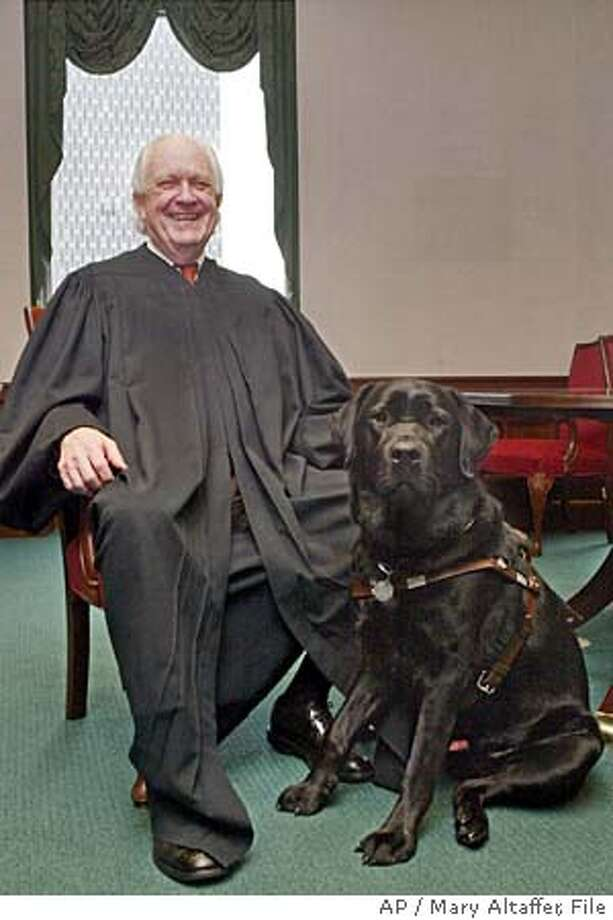 ** FILE ** Judge Richard Casey sits for a portrait with his dog, Barney, in this April 8, 2004 file photo, in New York. In a highly anticipated ruling, Judge Casey found the Partial-Birth Abortion Ban Act unconstitutional Thursday because it does not include a health exception. (AP Photo/Mary Altaffer, File) APRIL 8, 2004 FILE PHOTO Photo: MARY ALTAFFER