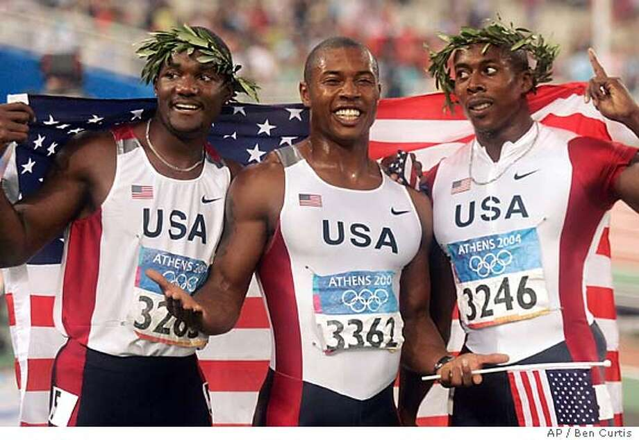 Americans Justin Gatlin, left, Bernard Williams, center, and Shawn Crawford, right, celebrate after sweeping in the 200-meter finals during the 2004 Olympic Games in Athens, Thursday Aug. 26, 2004. Crawford won the gold, Williams the silver and Gatlin the bronze. (AP Photo/Ben Curtis) Photo: BEN CURTIS
