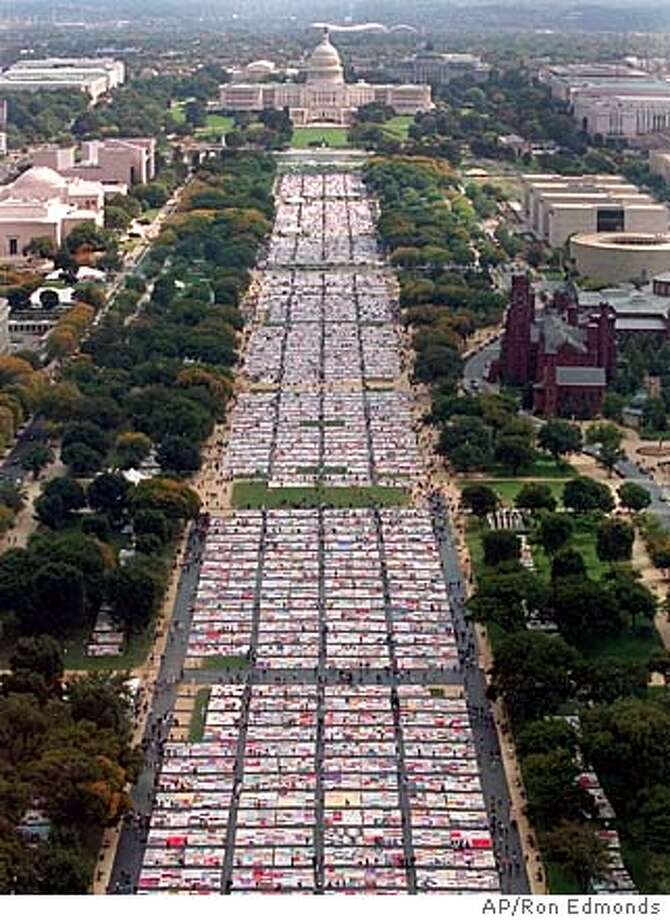 A view from the Washington Monument Friday October 11, 1996 shows the huge AIDS Quilt laying on the ground stretching from the monument to the U.S. Capitol.(AP Photo/Ron Edmonds), 02/06/2001 Photo: RON EDMONDS