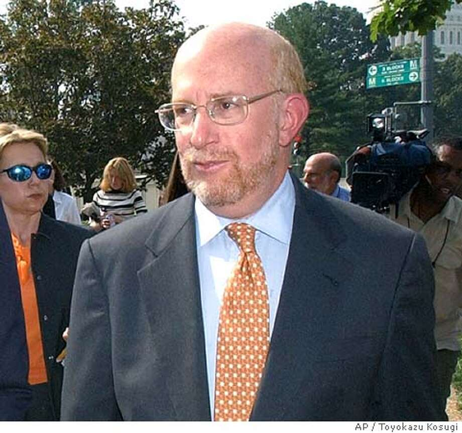 ** FILE ** Attorney Benjamin Ginsberg walks to the Supreme Court in Washington in this Oct. 3, 2002 photo. Ginsberg who also has been advising a veterans group running TV ads against Democrat Sen. John Kerry resigned Wednesday Aug. 25, 2004, from Bush's campaign. (AP Photo/Toyokazu Kosugi, File) AN OCT. 3, 2002 PHOTO Photo: TOYOKAZU KOSUGI