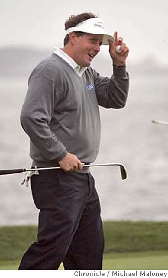 AT&T_311_MJM.jpg  Phil Mickelson tips his hat after sinking his putt on the 18th green to win the tournament.  Third day of the AT&T Pebble Beach National Pro-Am Golf Tournament.  Photo by Michael Maloney / San Francisco Chronicle MANDATORY CREDIT FOR PHOTOG AND SF CHRONICLE/ -MAGS OUT Photo: Michael Maloney