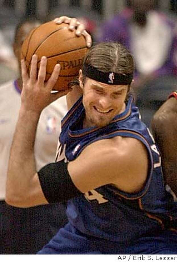 ** FILE ** Washington Wizards forward Christian Laettner, left, keeps the ball away from Atlanta Hawks guard Jason Terry during the second half in this March 12, 2004 photo, in Atlanta. The Dallas Mavericks got a big man, completing an eight-player deal Tuesday that will bring Erick Dampier from Golden State. Dallas sent Christian Laettner, Eduardo Najera, two future first-round draft picks and the draft rights to guards Luis Flores and Mladen Sekularac to the Warriors for Dampier, Dan Dickau, Evan Eschmeyer and the draft rights to Steve Logan. Laettner, a 12-year veteran, spent the last three seasons in Washington before being traded back to Dallas on draft night. (AP Photo/Erik S. Lesser) A MARCH 12, 2004 FILE PHOTO Photo: ERIK S. LESSER