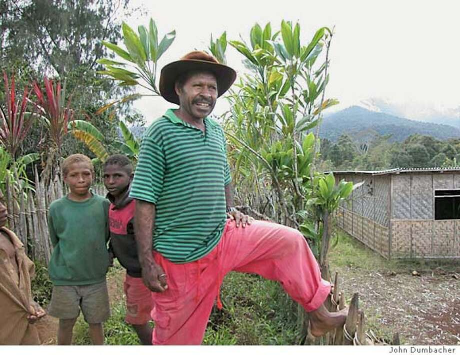 This is Avit Wako with one of his sons - he is the guy who collected the Nanisani beetles in his native village and kicked off this work. He is the second author on our PNAS paper that came out last fall. Courtesy of John P. Dumbacher Photo: Courtesy Of John P. Dumbacher
