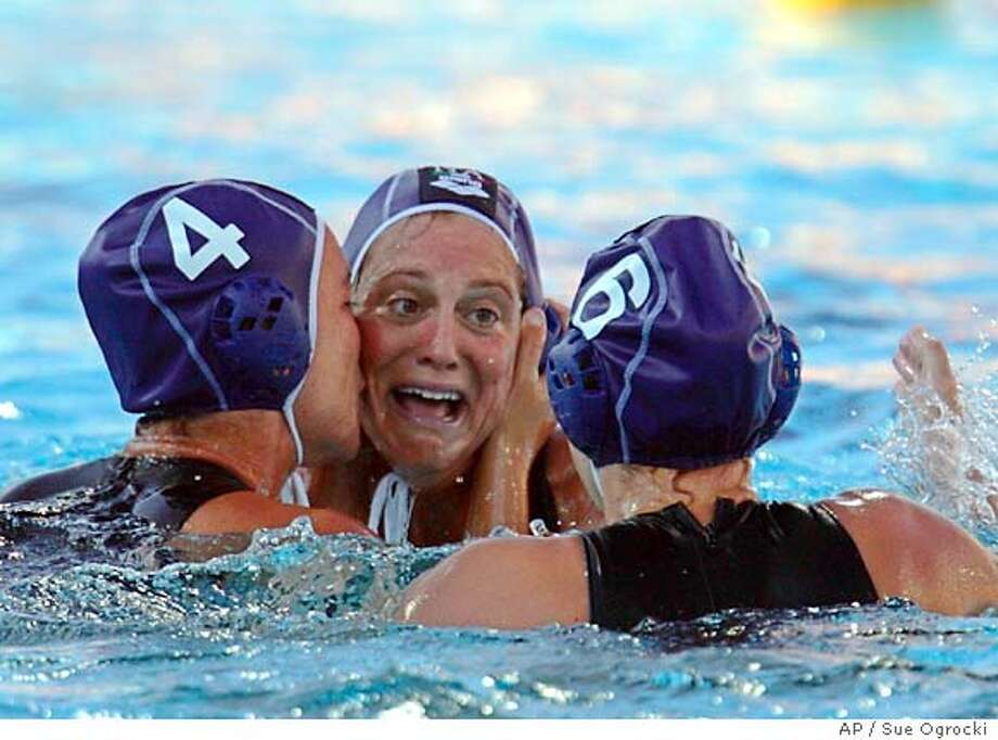 Silvia Bosurgi (4), Martina Miceli, center, and Manuela Franchi (6) celebrate Italy's 6-5 win over the USA in a semi final match of the Women's water polo competition at the 2004 Olympic Games in Athens, Tuesday, Aug. 24, 2004. Franchi's goal with two seconbds left sends Italy to the gold medal match against Australia or Greece. (AP Photo/Sue Ogrocki) Photo: SUE OGROCKI