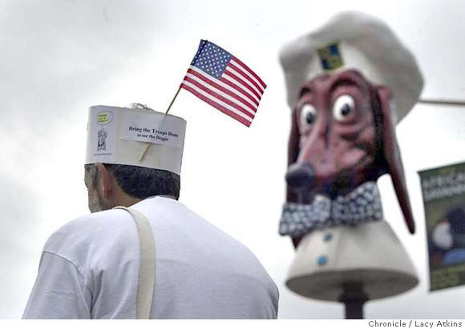 Joel Schechter of the Oacean Beach Historical Society wears his keep the doggie diner mascot hat to the celebration at Sloat and 45th Street in San Francisco, Feb.14, 2005. THE SAN FRANCISCO DEPARTMENT OF PUBLIC WORKS, MAYOR GAVIN NEWSOM AND MEMBERS OF THE BOARD OF SUPERVISORS WILL CELEBRATE THE RELOCATION OF THE 700-POUND DOGGIE DINER HEAD, A SMILING FIBERGLASS DACHSHUND WEARING A CHEF�S HAT THAT USED TO BE THE LOGO FOR A CHAIN OF BAY AREA DINERS, feb 14, 2005. LACY ATKINS/SAN FRANCISCO CHRONICLE Photo: LACY ATKINS