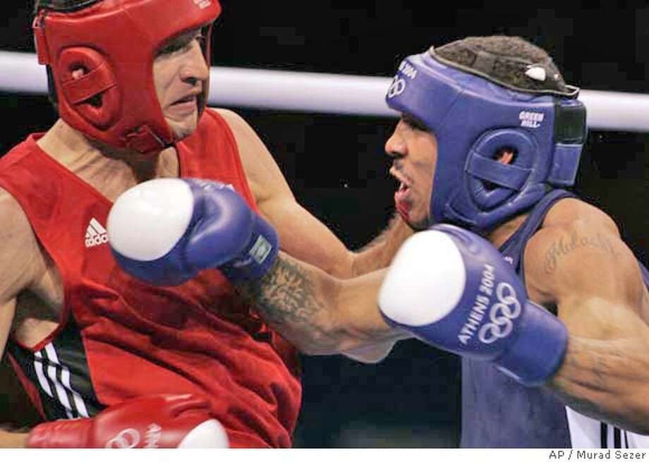 American Andre Ward, right, from Oakland, Calif., and Russia's Evgeny Makarenko exchange punches during the light heavyweight boxing quarterfinals in the 2004 Athens Summer Olympic Games at the Peristeri boxing hall in Athens Tuesday, Aug. 24, 2004. Ward won the match. (AP Photo/Murad Sezer) Photo: MURAD SEZER