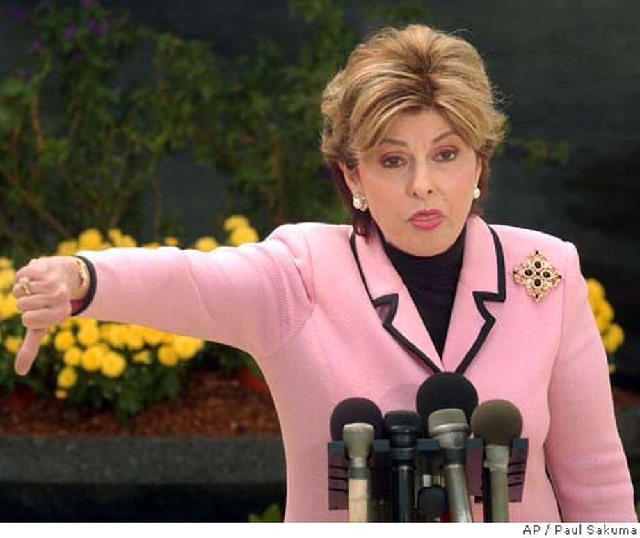 Amber Frey's attorney Gloria Allred gestures at a news conference outside of a Redwood City, Calif., courthouse, Tuesday, Aug. 24, 2004, about Scott Peterson's attorney Mark Geragos. Geragos questioned Frey for a second day on Tuesday. Peterson is the Modesto, Calif., man who could face the death penalty for the murder of his wife, Laci Peterson, and their unborn son. (AP Photo/Paul Sakuma) Photo: PAUL SAKUMA