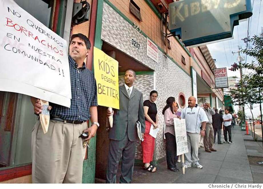 Neighbors gathering outside Kibby's bar in Oakland's Fruitvale district demanding that the bar's owner deal with unruly patrons or face being shut down by the city for being a public nuisance.  Event on 8/23/04 in Oakland.  Chris Hardy / San Francisco Chronicle Photo: Chris Hardy