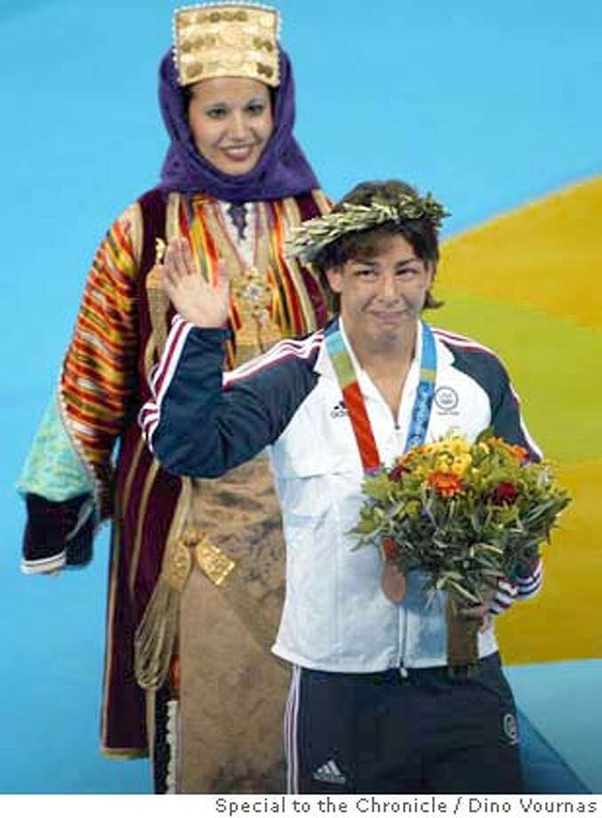24olywrestling8.jpg 8/23/04  The gold medal match was not to be for US Olympic wrestler Patricia Miranda but she did manage a Bronze Medal, besting Angelique Berthenet of France in the 105.5 lb. category at the Athens Olympics. Dino Vournas / Special To The Chronicle