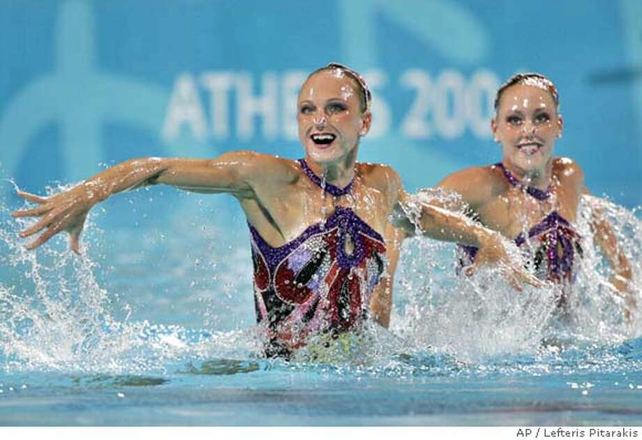 United States' Anna Kozlova, left, and Alison Bartosik perform in the duet techical routine in synchronised swimming, in the Olympic Aquatic Center at the 2004 Olympic Games in Athens, Monday Aug. 23, 2004. (AP Photo/Lefteris Pitarakis) Photo: LEFTERIS PITARAKIS